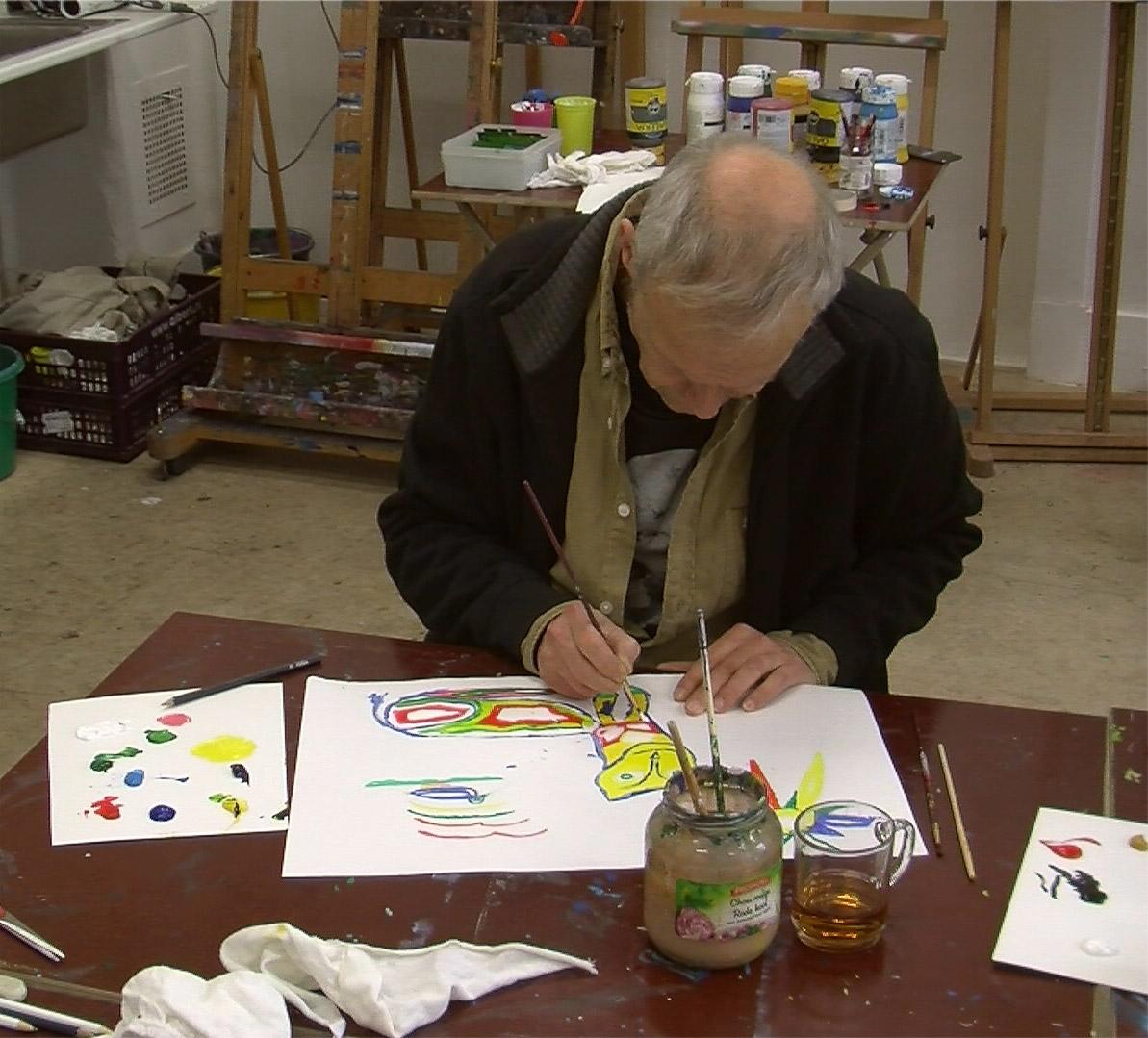 Maarten schilderend tijdens de cursus